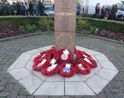 Poppy wreaths in the middle of the Square Memorial in Wolverton.