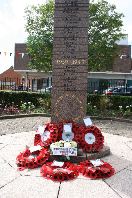 Poppy wreaths at the Memorial in The Square, Wolverton.