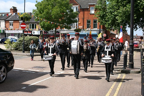 Wolverton Town Band marching in the Square.